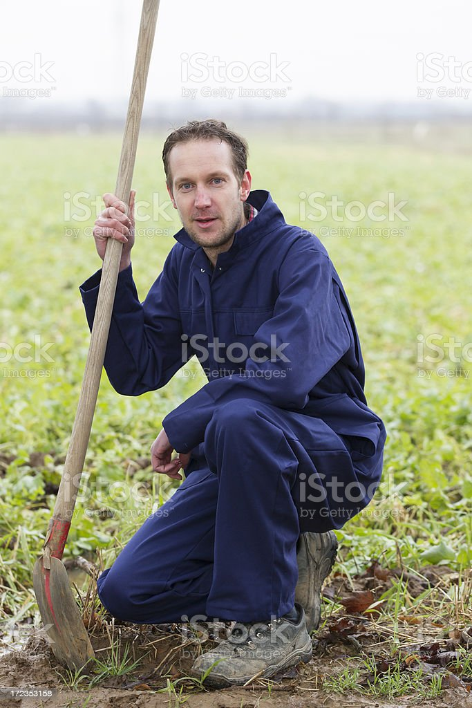 Farmer is working on field royalty-free stock photo