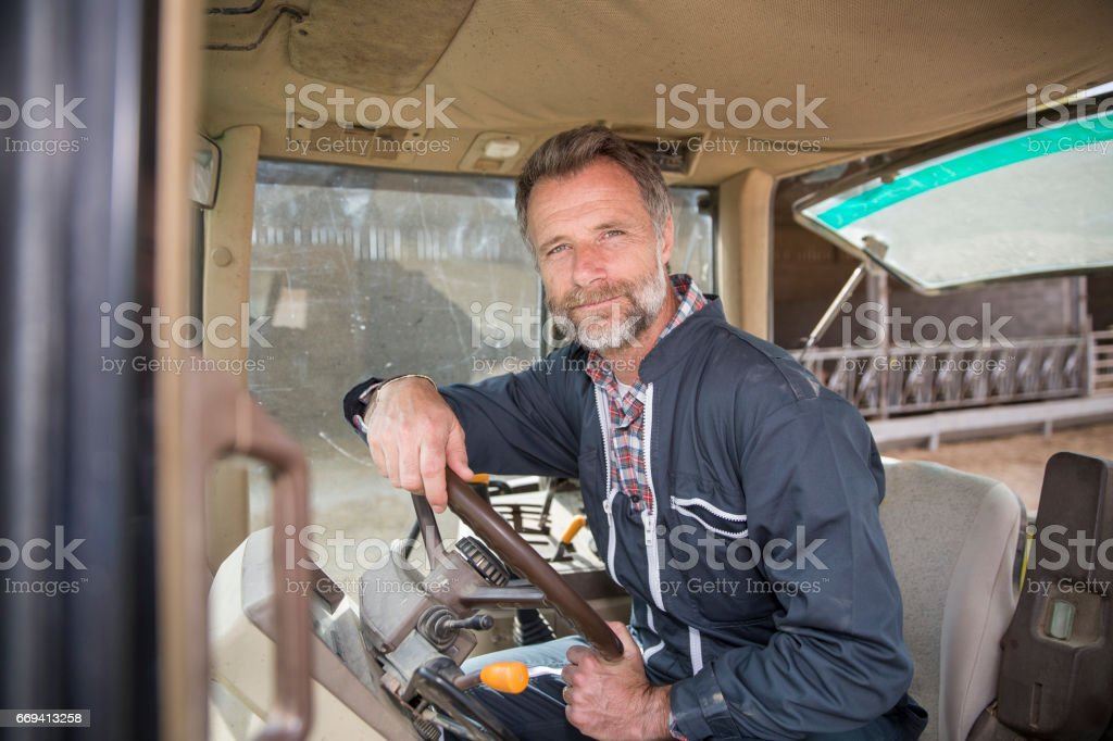 e0b1c020c4c6d Farmer Leaning On The Tractor Stock Photo - Download Image Now - iStock
