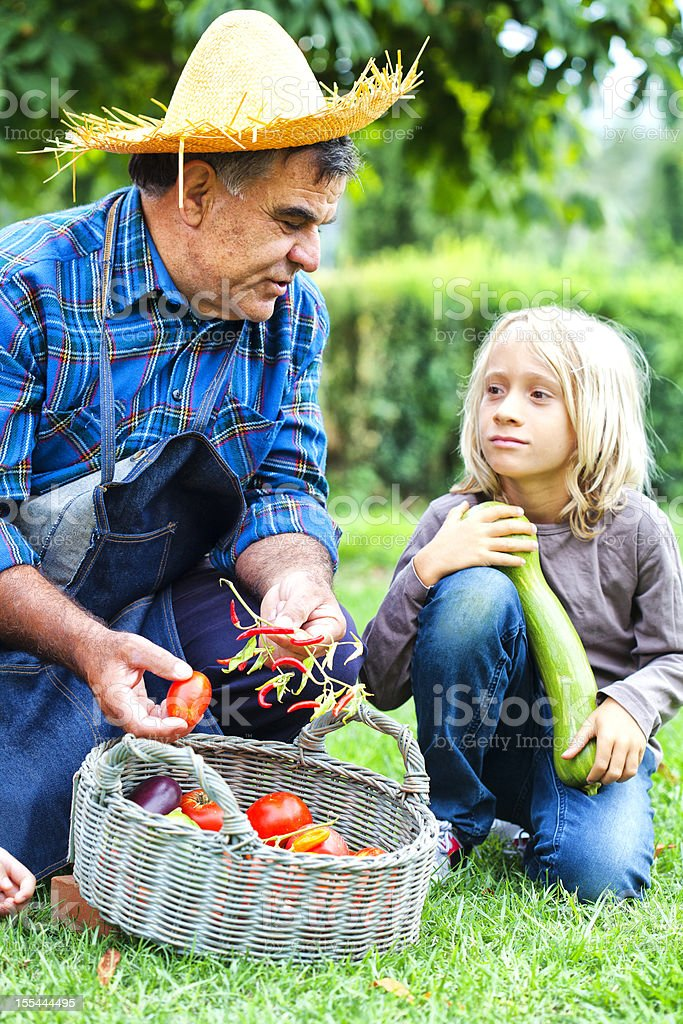 Farmer Man with Child in Countryside stock photo
