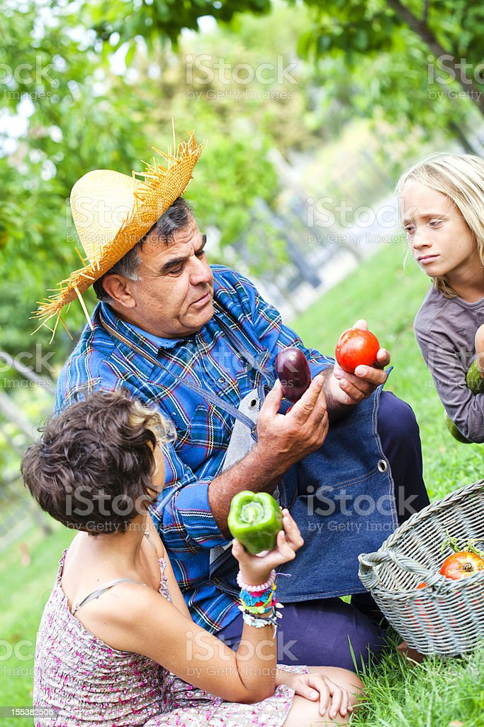 Farmer Man with Children in Countryside stock photo