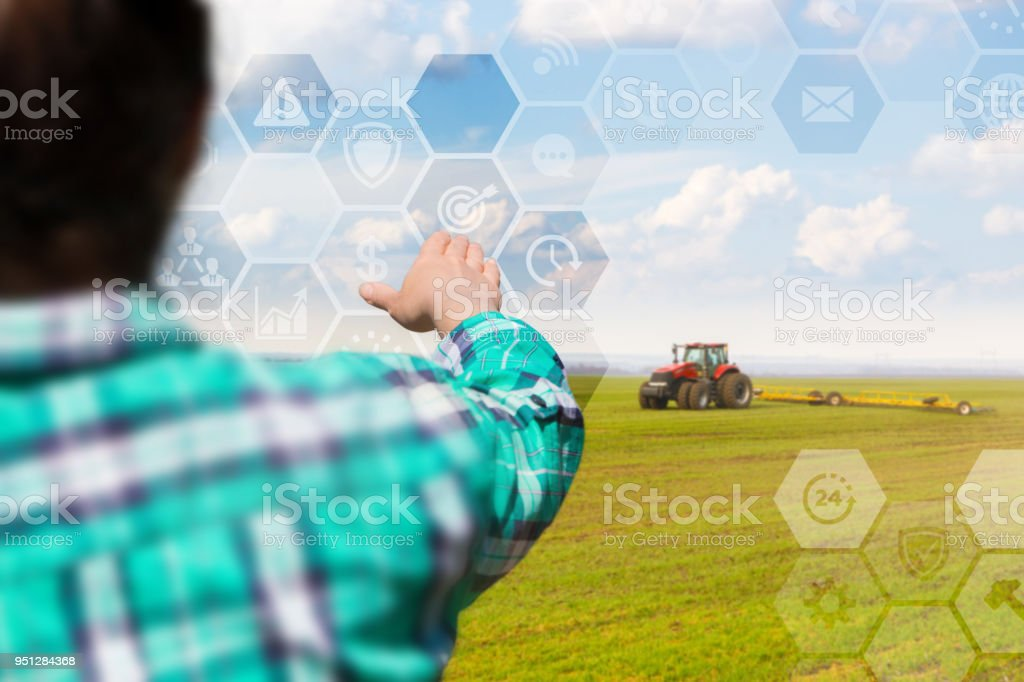Farmer manages planting on the virtual screen. stock photo