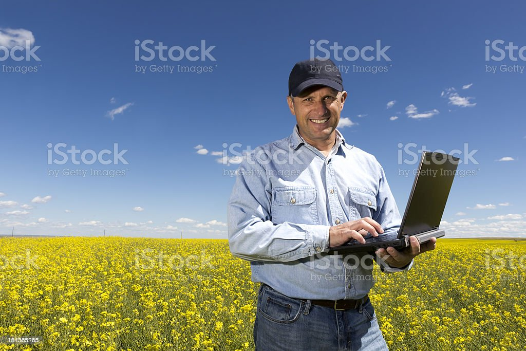 Farmer on his Computer royalty-free stock photo