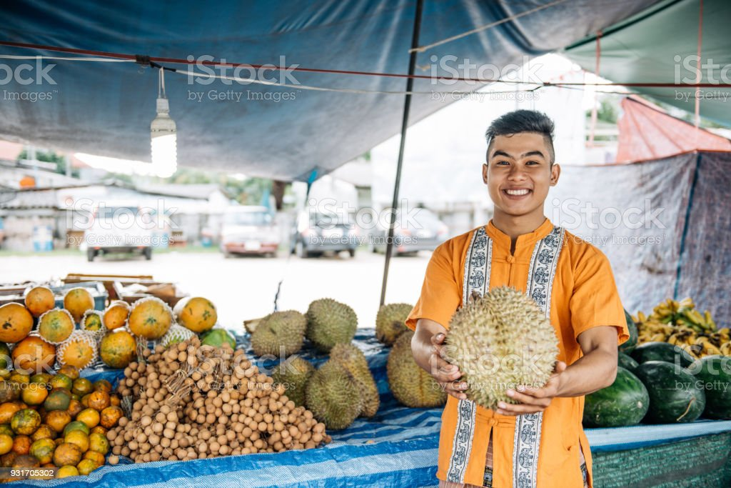 Farmer on market selling durian stock photo