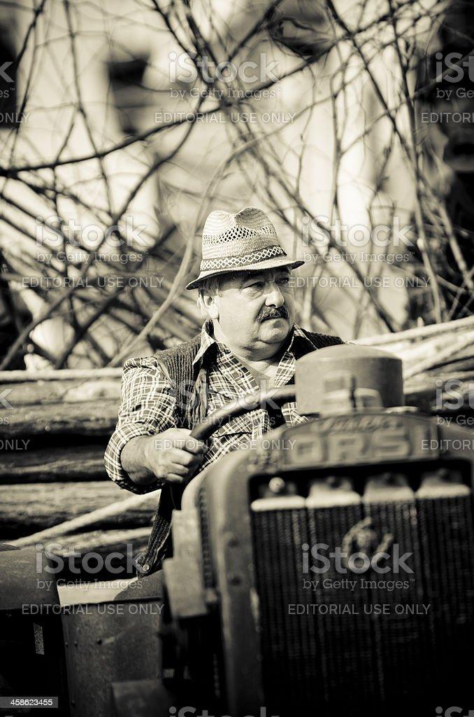 Farmer on tractor, rural scene stock photo