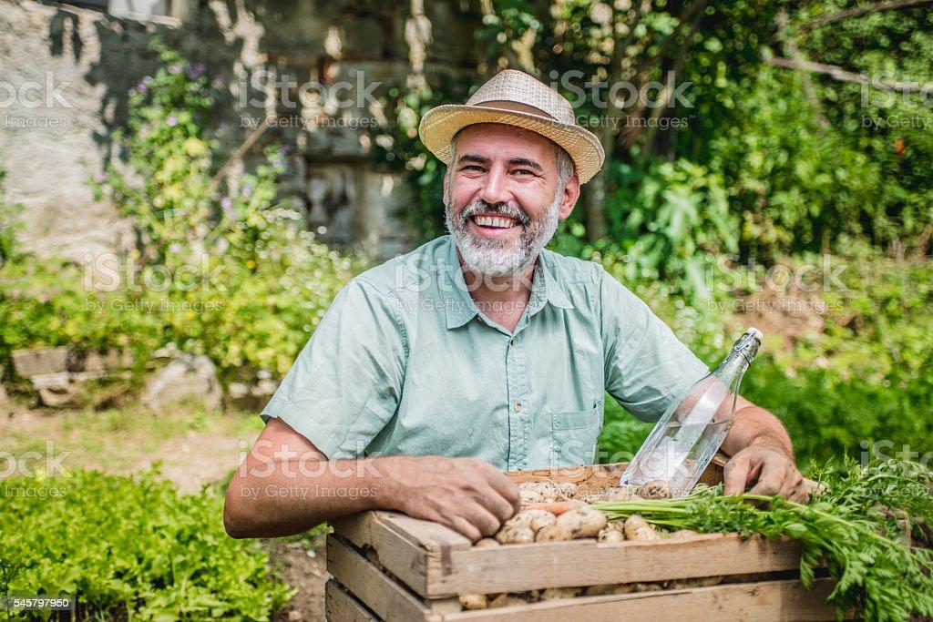 Farmer portrait holding his crops stock photo
