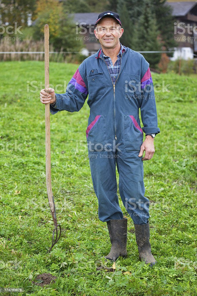 Farmer posing with Pitch Fork stock photo