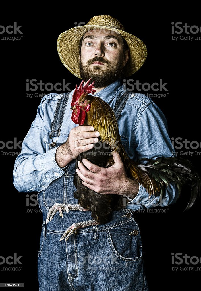 Farmer proud of his rooster stock photo
