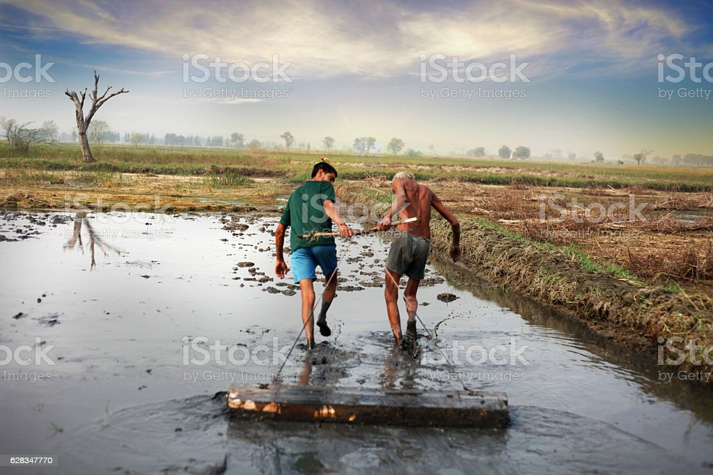 Farmer pulling agriculture equipment stock photo