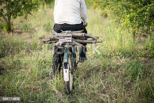 istock Farmer riding old bicyle 536774609