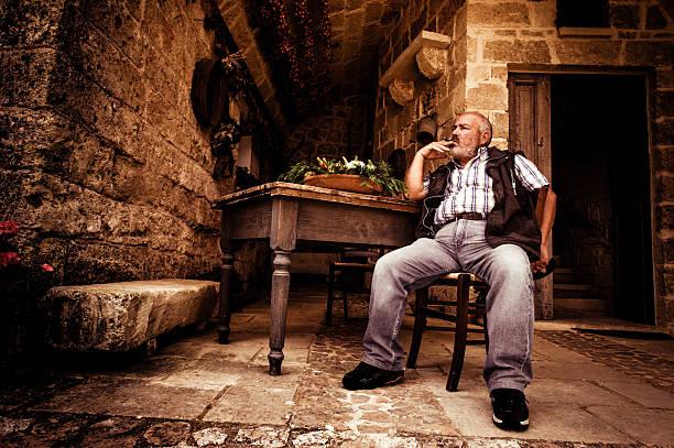 Farmer smoking a cigar stock photo