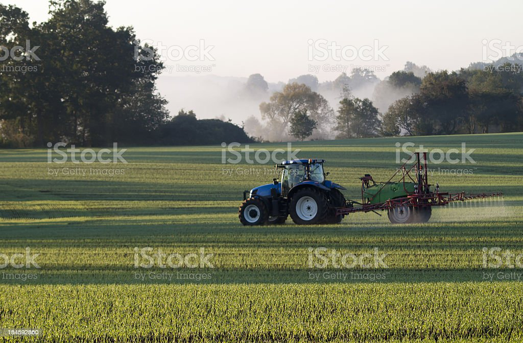 Farmer spraying field royalty-free stock photo