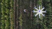 Farmer spraying his crops using a drone