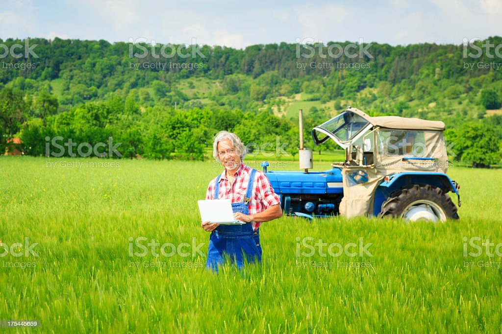 farmer standing in a field royalty-free stock photo