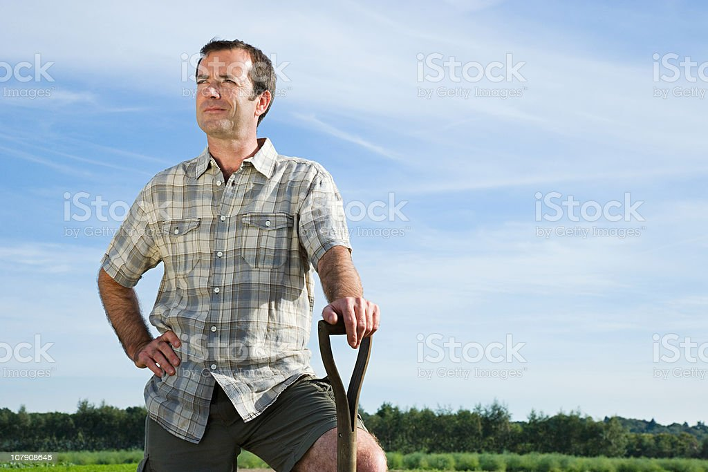 Farmer standing in field stock photo