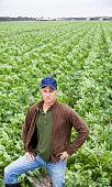 istock Farmer standing in field 175402559