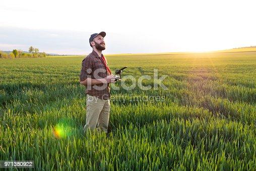 istock Farmer using a drone 971380922