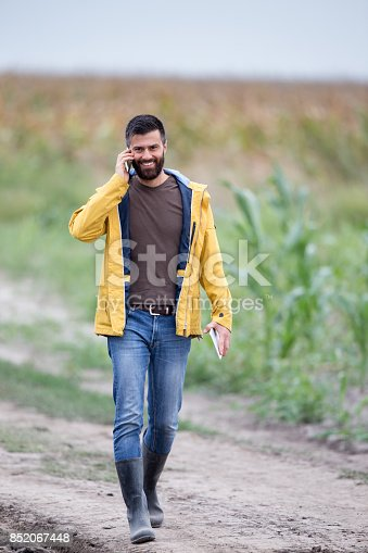 istock Farmer walking on farmland 852067448