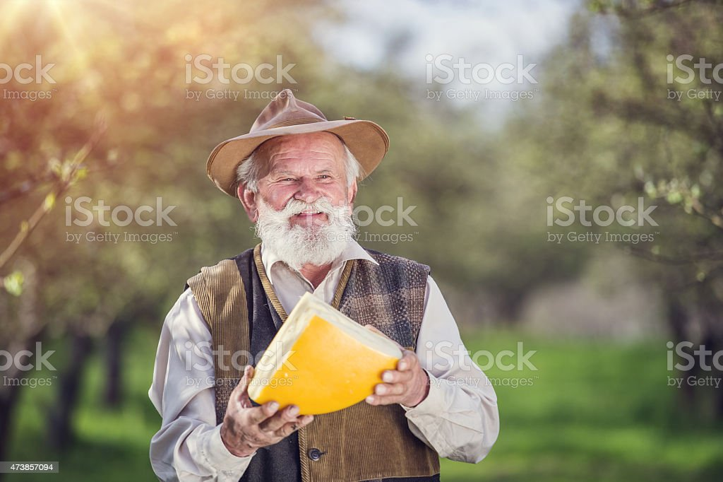 Farmer with cheese royalty-free stock photo