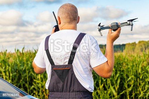 istock Farmer with drone at corn field 857426340