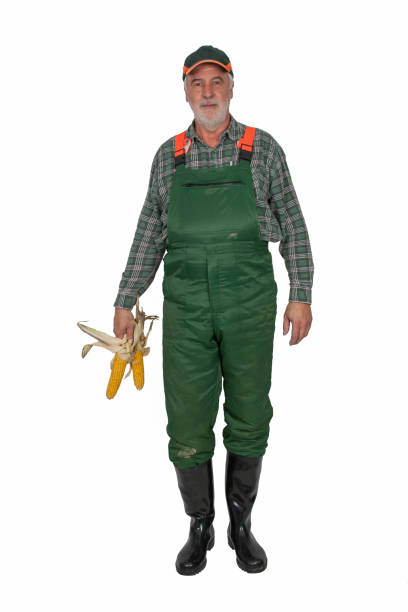 Farmer with green dungarees and black rubber. stock photo