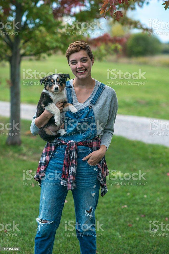 Farmer with Her Puppy - foto de stock