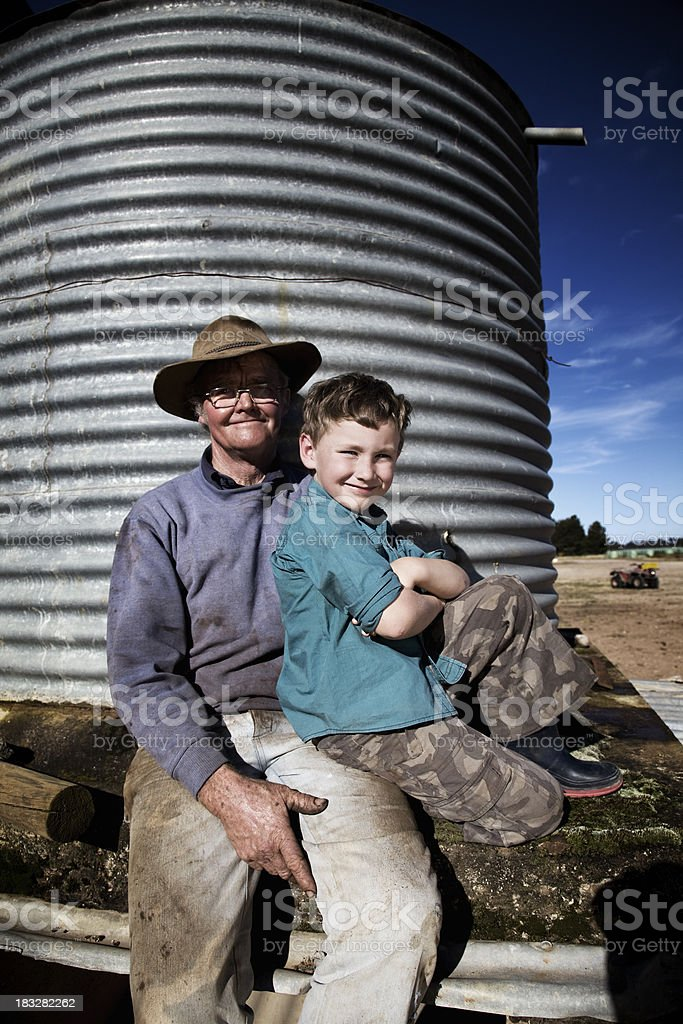 Farmer with his Grandson royalty-free stock photo
