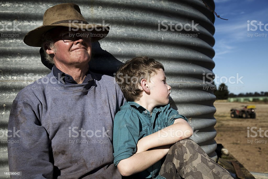 Farmer with his Grandson stock photo