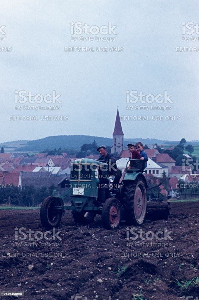 Farmer With His Sons Stock Photo - Download Image Now - iStock