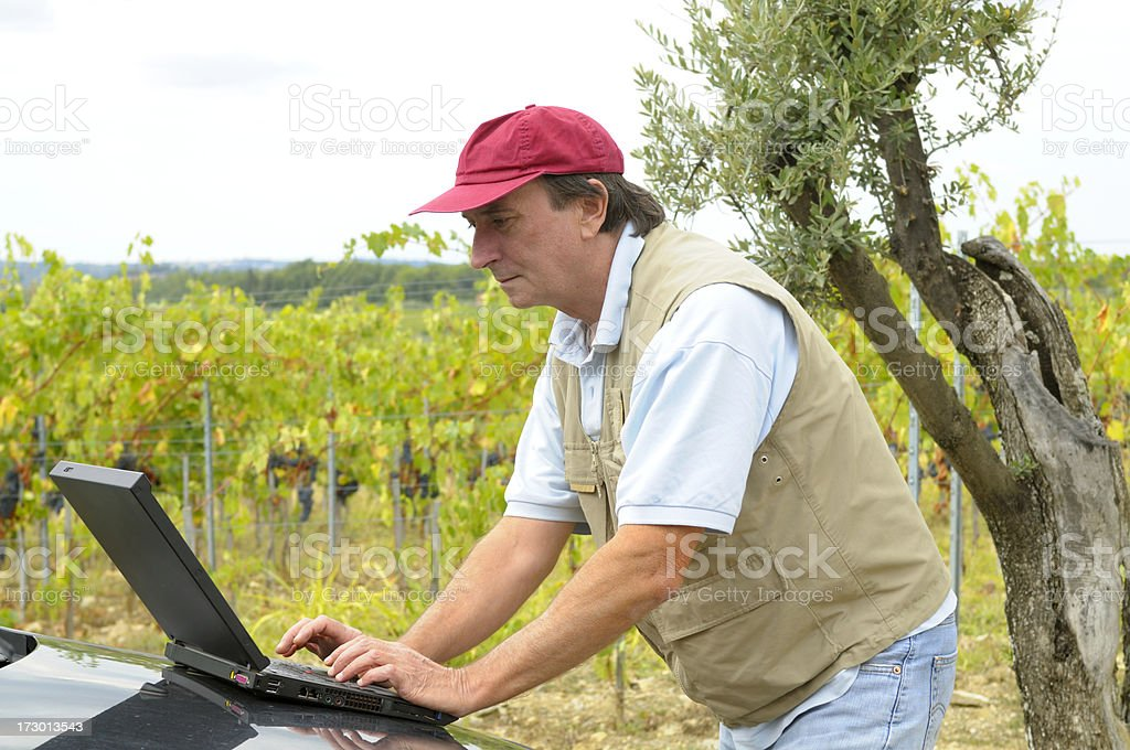 Farmer with laptop royalty-free stock photo