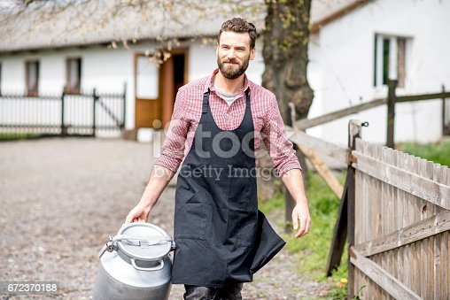 istock Farmer with milk outdoors 672370188