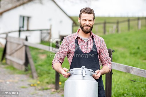 istock Farmer with milk outdoors 672371614