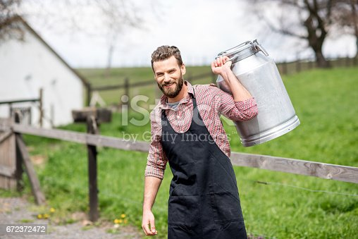 istock Farmer with milk outdoors 672372472