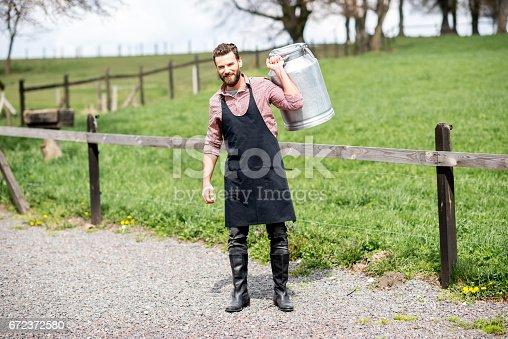 istock Farmer with milk outdoors 672372580