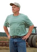 istock farmer with Tractor portrait 182910647