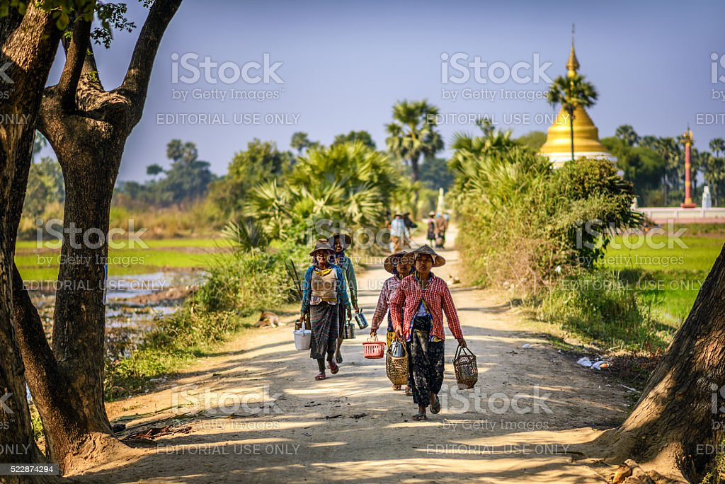 farmer workers in traditional straw hats  in Mandalay, Myanmar stock photo