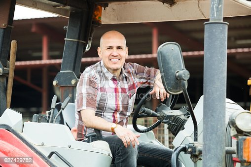 istock Farmer working at agricultural machinery 627429782