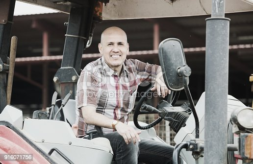 istock Farmer working at agricultural machinery 916071756