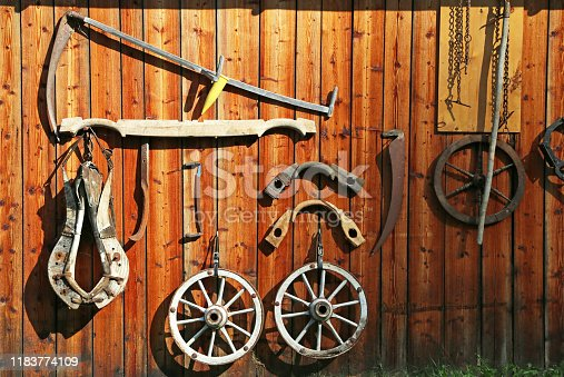wooden wall with historic farmer tools