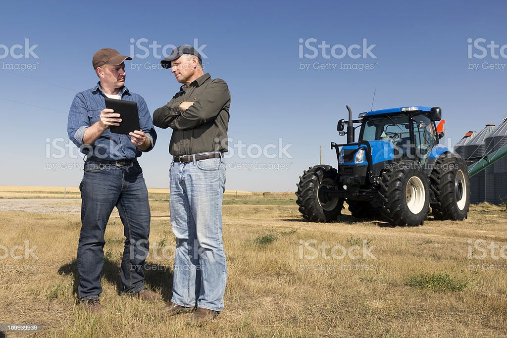 Farmers and Technology stock photo