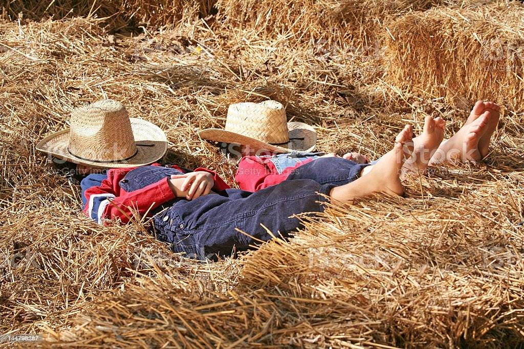 Farmers Asleep in the Hay stock photo