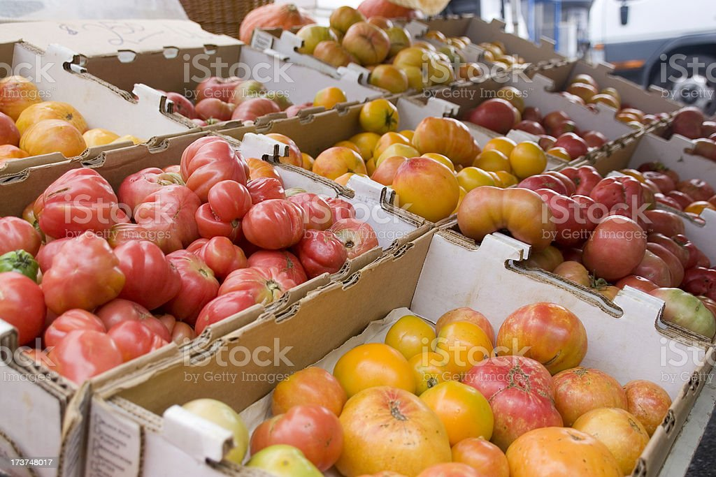 Farmers Market: Boxes of Heirloom Tomatoes royalty-free stock photo