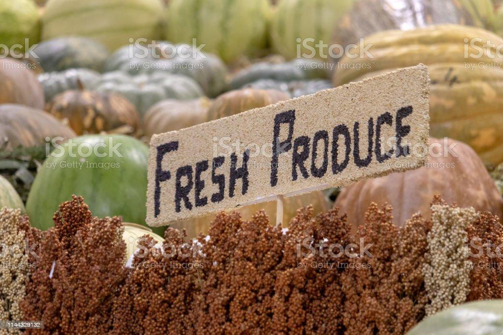 Farmers Market with Fresh Produce sign amongst fresh produce. Sign.