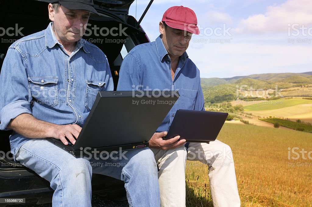 Farmers Planning PC in the Countryside stock photo