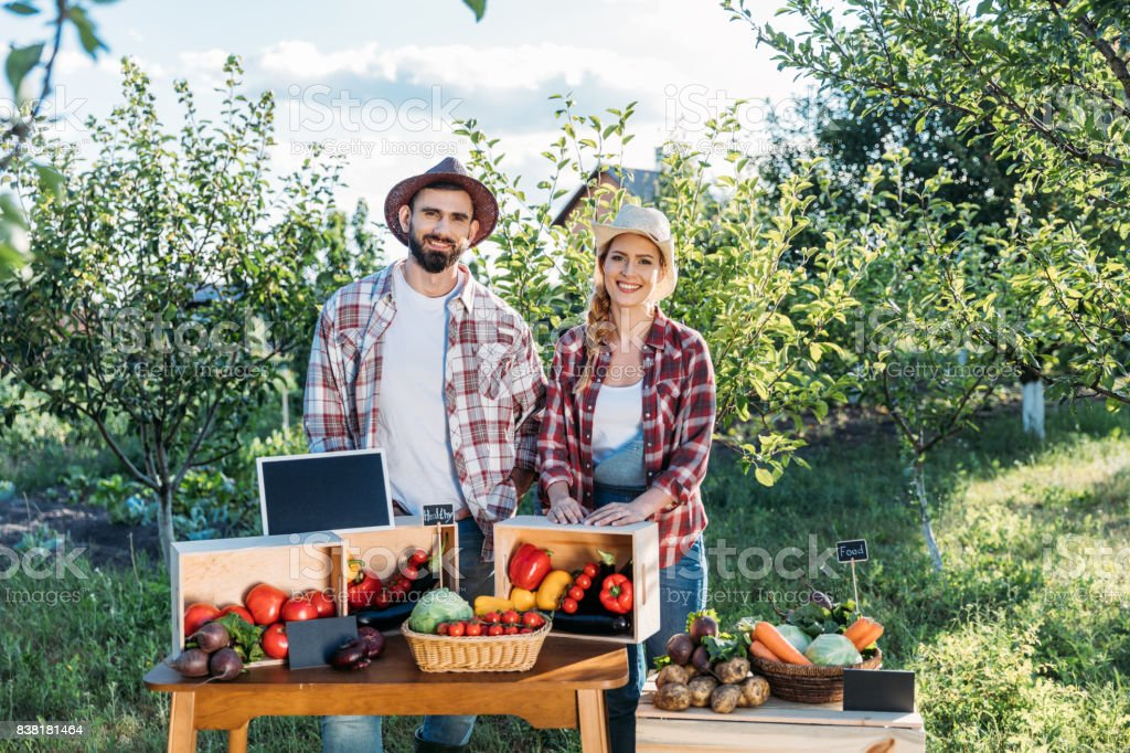 farmers selling vegetables stock photo