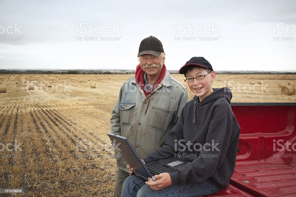 Farmers with Computer stock photo