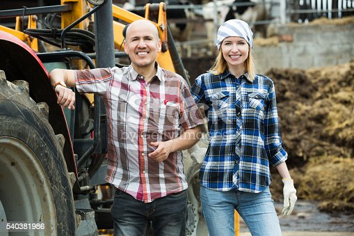 istock Farmers working at machinery 540381986