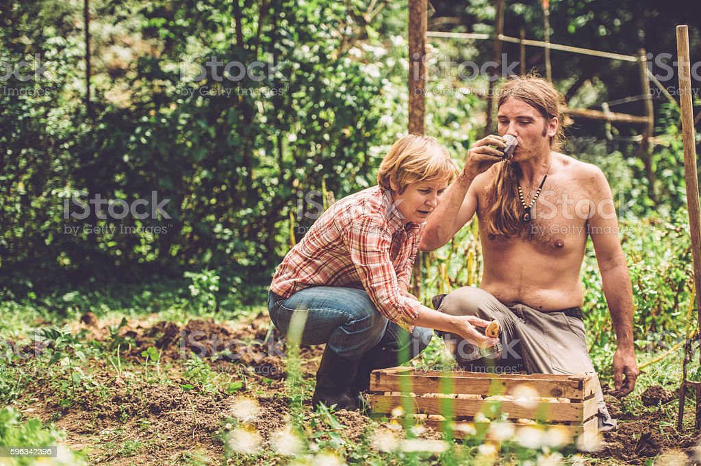 Farmers Working in Their Garden royalty-free stock photo
