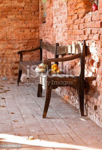 Rural farmhouse environment with a wood antique classic rustic bench