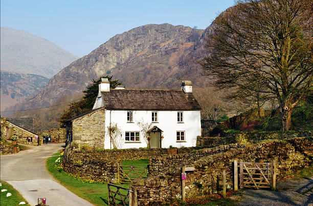 Farmhouse cottage on Yew Tree Farm Farmhouse cottage on Yew Tree Farm in the English Lake District was once the home of Beatrix Potter who bequeathed it to the National Trust in her will english lake district stock pictures, royalty-free photos & images