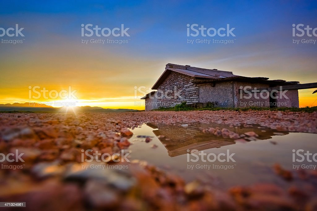 Farmhouse made of Stones at Sunrise royalty-free stock photo